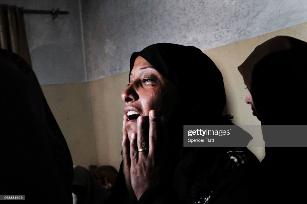 Relatives of eight-month-old Leila Anwar Ghandoor, who died in the hospital on Tuesday morning from tear gas inhalation, grieve at her home before her burial on May 15, 2018 in Gaza City, Gaza. Anwar was with a relative during the violence at the Gaza-Israel border yesterday when tear gas canisters were fired at crowds. Israeli soldiers killed over 50 Palestinians and wounded over a thousand as demonstrations on the Gaza-Israel border coincided with the controversial opening of the U.S. Embassy in Jerusalem. This marks the deadliest day of violence in Gaza since 2014. Gaza's Hamas rulers have vowed that the marches will continue until the decade-old Israeli blockade of the territory is lifted.