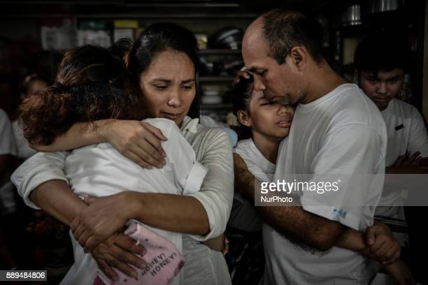 Relatives of Ephraim Escudero who was killed by unidentified assailants weep during his funeral in San Pedro Laguna south of Manila Philippines...