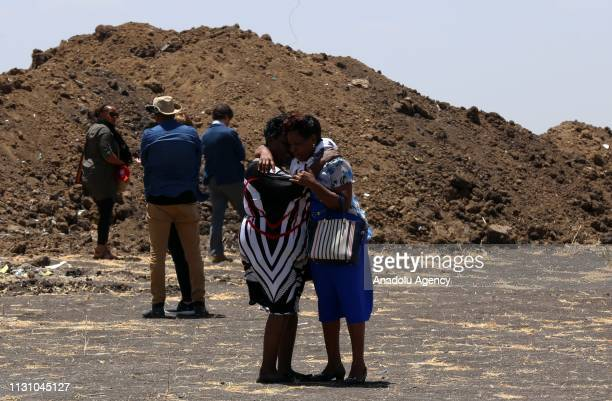 Relatives of Ethiopia Airlines victims who lost their lives in the crash mourn at the crash site of Ethiopian Airlines Flight 302 in Addis Ababa...