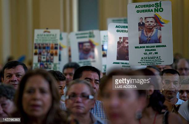 Relatives of FARC hostages attend a mass at the cathedral of Villavicencio, Colombia, on April 1, 2012. Helicopters provided by Brazil are scheduled...