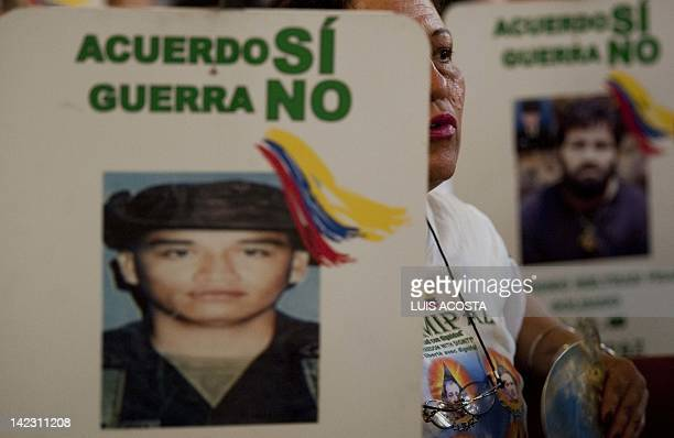 Relatives of FARC hostages attend a mass at the cathedral of Villavicencio Colombia on April 1 2012 Helicopters provided by Brazil are scheduled to...