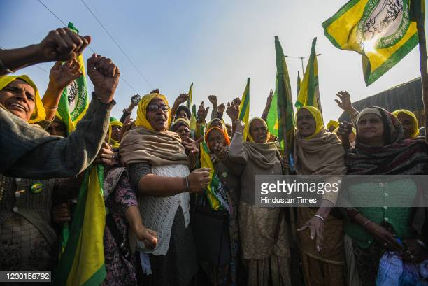 Relatives of farmers who are believed to have died by suicide over debt issues, congregate during the ongoing protest against new farm laws, at Tikri...