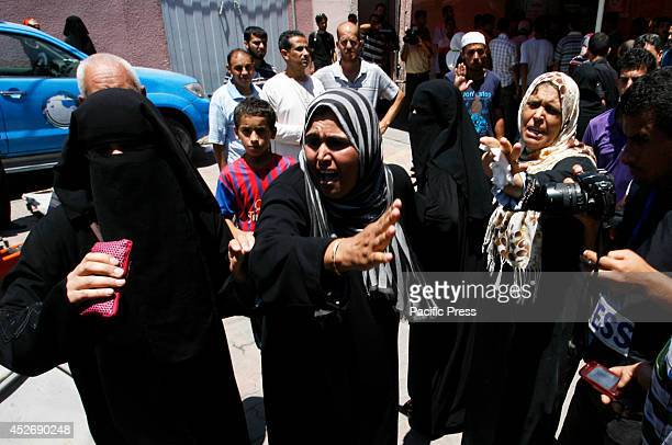 Relatives of four Palestinian brothers from Abu Shaqra family whom medics said were killed by an Israeli air strike mourn during their funeral in...