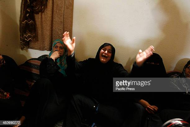Relatives of four Palestinian brothers from Abu Shaqra family, whom medics said were killed by an Israeli air strike, mourn during their funeral in...