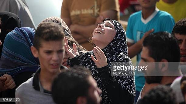 Relatives of four Palestinian children from the Baker family whom medics said were killed by a shell fired by an Israeli naval gunboat mourn during...