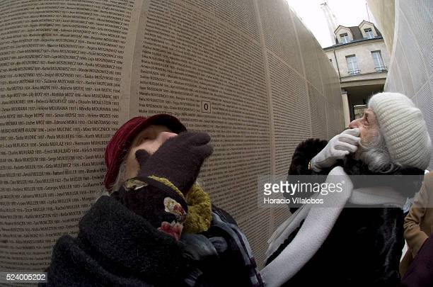 Relatives of French deported Jews visit the Wall of Names at the Shoah Memorial in Paris The wall contains the names of 76000 French Jews deported...