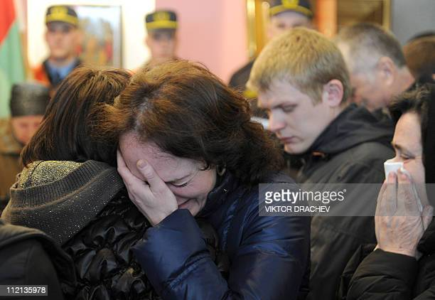 Relatives of Galina Pikulik a victim of the Minsk metro bombing that killed 12 and wounded 200 on April 11 cry during a funeral ceremony in Minsk on...