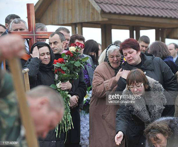 Relatives of Galina Pikulik a victim of the Minsk metro bombing that killed 12 and wounded 200 on April 11 mourn during the funeral ceremony in Minsk...