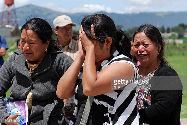 Relatives of Hector Bocel one of eight police officers killed by an armed commando at a police station cry outside the morgue in the Salcaja...