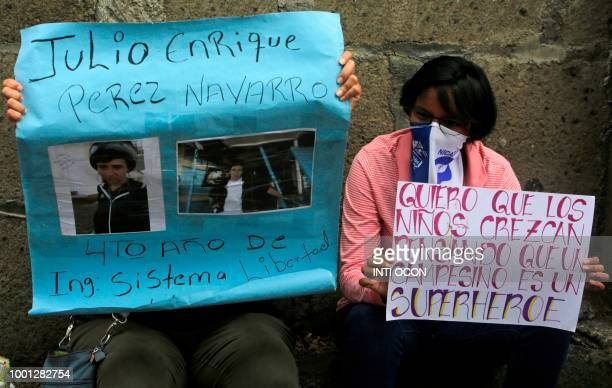 Relatives of imprisoned protesters hold their portraits outside 'El Chipote' prison in Managua while demanding the release of their beloved ones on...