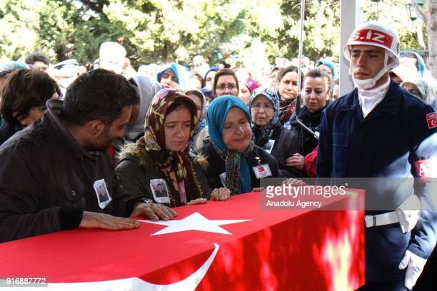 Relatives of Infantry Sergeant Serdar Ege who was martyred within the Operation Olive Branch in Syria's Afrin region mourn over his flagdraped coffin...