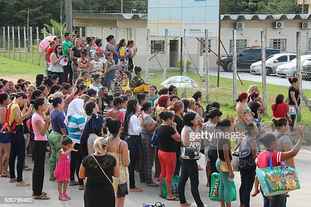 Relatives of inmates ask for information at the main gate of the Anisio Jobim Penitentiary Complex after a riot left at least 60 people killed and...