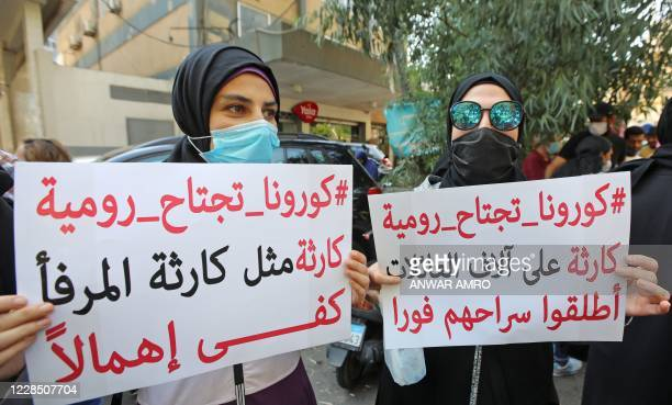 Relatives of inmates at Roumieh prison stage a demonstration outside the ministry of justice in the Lebanese capital Beirut on September 14 calling...