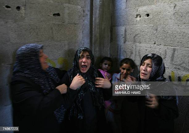 Relatives of Jamal Abu alJadian a head for northern Gaza of AlAqsa Martyrs Brigades loosely affiliated to Fatah mourn during his funeral in Beit...