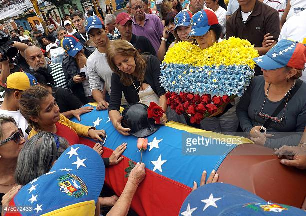 Relatives of Jimmy Vargas a student who died during a recent protest weep beside his coffin during his funeral in San Cristobal 660 km from Caracas...