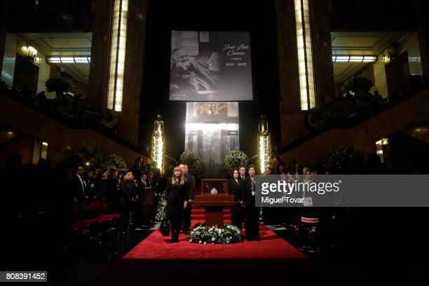 Relatives of Jose Luis Cuevas stand guard during an homage to Mexican artist Jose Luis Cuevas at Bellas Artes Palace on July 04 2017 in Mexico City...