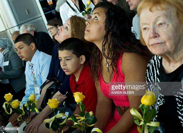 Relatives of journalist Marie Colvin who was killed in Syria listen at the Newseum's Journalists Memorial during the reading of names of fallen...