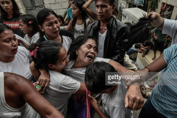 Relatives of Kenneth Trasmano who was killed in a police drug sting operation weep during his funeral in Manila Philippines February 10 2018 More...