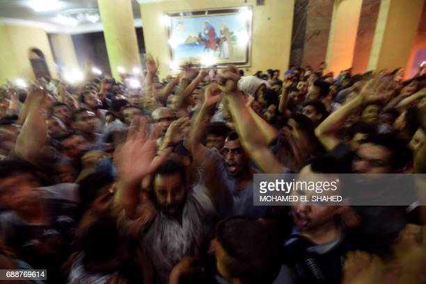 Relatives of killed Coptic Christians gather at the Abu Garnous Cathedral in the north Minya town of Maghagha on May 26 during the funeral of the...