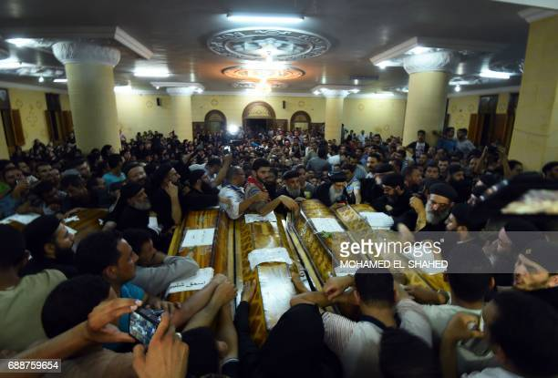 Relatives of killed Coptic Christians grieve during their funeral at Abu Garnous Cathedral in the north Minya town of Maghagha on May 26 2017 Egypt...