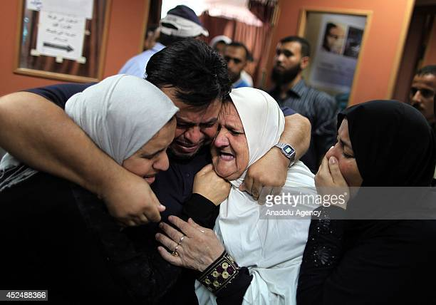 Relatives of killed Palestinians mourn when Israel shelled the AlAqsa Martyrs Hospital in the central Gaza Strip left four Palestinians killed and...