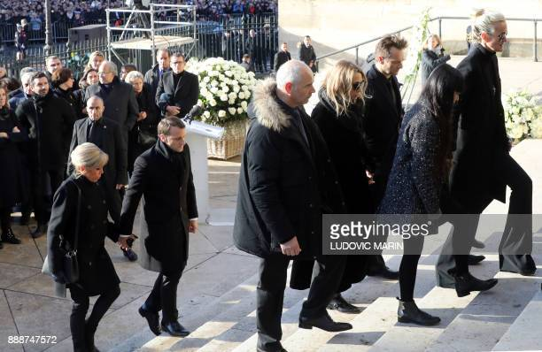 Relatives of late French singer Johnny Hallyday his wife Laeticia his son David his daughter Laura and Brigitte Macron and French president Emmanuel...