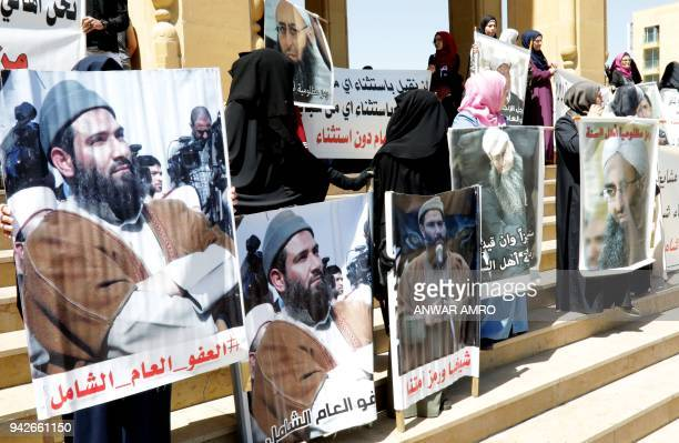 Relatives of Lebanese nationals accused of links to extremist groups gather during a protest outside the Mohammad alAmin mosque in downtown Beirut on...