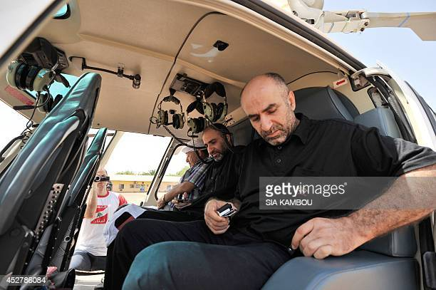 Relatives of Lebanese passengers killed in the crash of the Air Algerie flight AH 5017 board an helicoptere on July 27 2014 at the military base of...