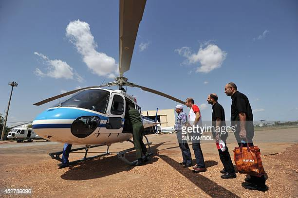 Relatives of Lebanese passengers killed in the crash of the Air Algerie flight AH 5017 wait on July 27 2014 at the military base of the Ouagadougou...