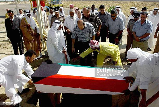 Relatives of Lebanese prisoner of war Daad Omar alHariri whose remains were found in a mass grave in southern Iraq bury her coffin draped in a...