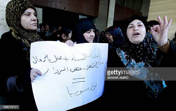 Relatives of Lebanese Shiite pilgrims kidnapped last May in Syria hold a placard and shout slogans during a protest in front of the Qatari embassy in...