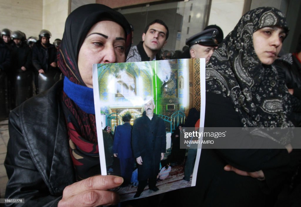 Relatives of Lebanese Shiite pilgrims kidnapped last May in Syria show pictures during a protest in front of the Qatari embassy in Beirut on January 10, 2013. A group of about 50 demonstrators picketed the embassy of Qatar, which backs Syria's anti-regime rebels. The abductions of 11 Lebanese Shiite pilgrims were claimed by Abu Ibrahim, a strongman in rebel territory in northern Syria that claims affiliation to the main rebel FSA.