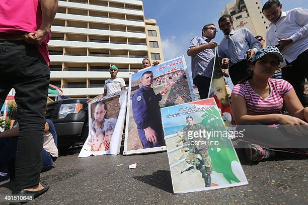 Relatives of Lebanese soldiers and policemen being held hostage by jihadists in Syria hold portraits during a protest to press for their release as...