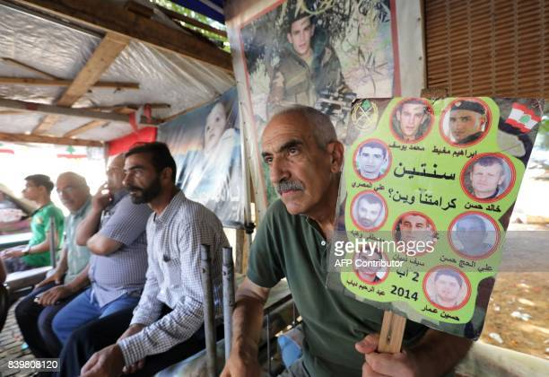 Relatives of Lebanese soldiers taken hostage by jihadists in 2014 sit inside a tent as they gather in downtown Beirut on August 27 2017 awaiting news...