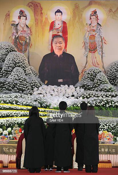 Relatives of Lee Chaohsiung one of the island's most prominent mafia leaders pray in front of his portrait during a memorial service in the central...