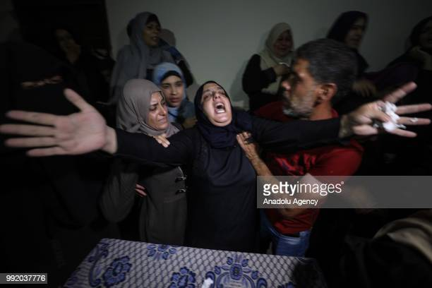 Relatives of Mahmud Macid Garbali who got wounded by Israeli soldiers during the opening ceremony of the US Embassy in Jerusalem on 14th May and lost...