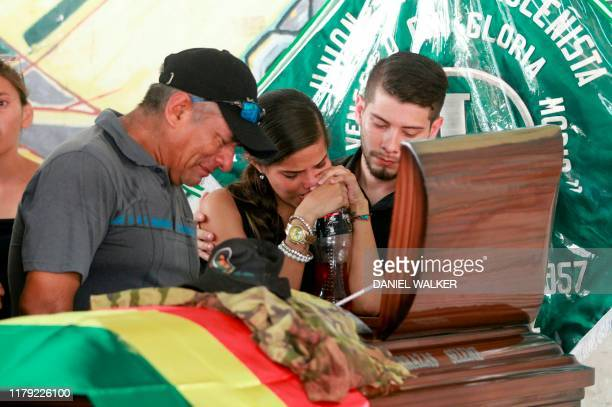 Relatives of Marcelo Terrazas Seleme who died yesterday during clashes between supporters of the Movimiento Al Socialismo party and supporters of...
