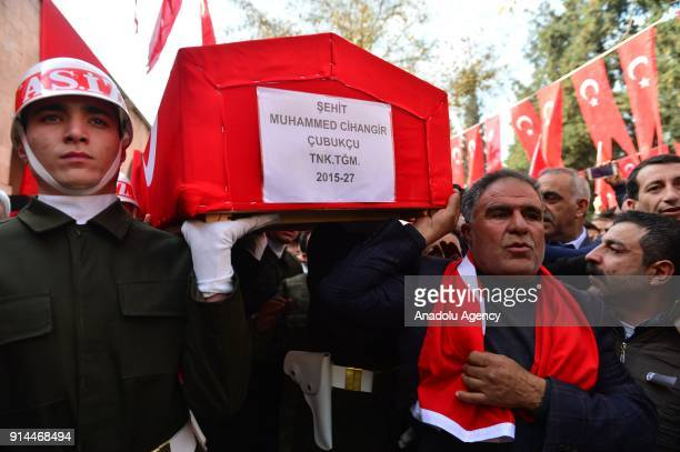 Relatives of martyred lieutenant Muhammed Cihangir Cubukcu who was martyred during the 'Operation Olive Branch'in Syria's Afrin region carry his...