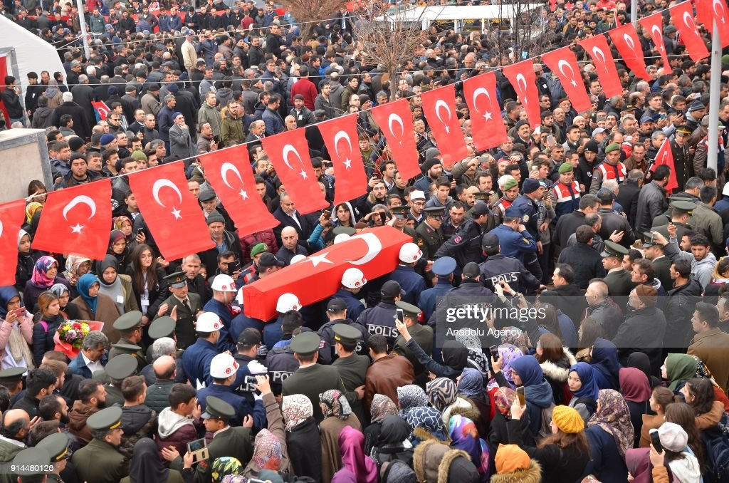 Relatives of martyred specialist corporal Halil Ibrahim Aygul, who was martyred after the terrorist group targeted a Turkish army tank during the 'Operation Olive Branch'in Syria's Afrin region, carry the coffin of him during a funeral ceremony in Corum, Turkey on February 05, 2018. Turkey launched Operation Olive Branch on January 20, 2018 at 5 p.m.(1400GMT) in Syrias northwestern Afrin region; the aim of the operation is to establish security and stability along Turkish borders and the region as well as to eliminate PKK/KCK/PYD-YPG and Daesh terror groups, and protect the Syrian people from the oppression and cruelty of terrorists.