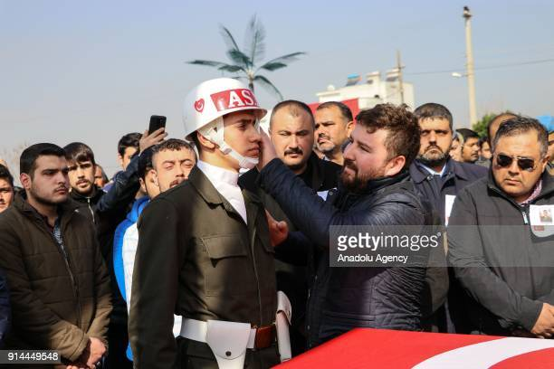 Relatives of martyred specialized infantry sergeant Selim Vurdal who was martyred during the 'Operation Olive Branch' mourn around his coffin during...