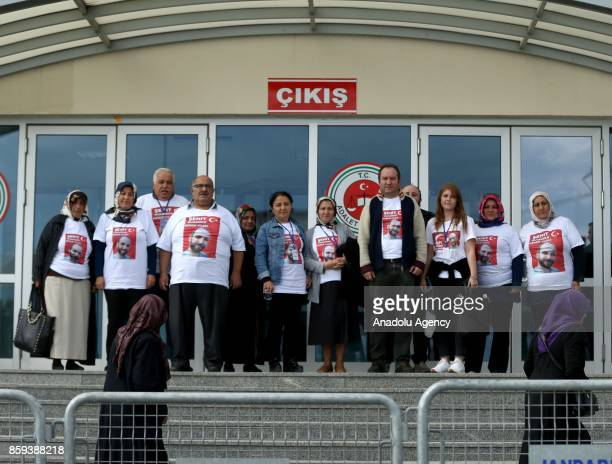 Relatives of martyrs wearing tshirts with the portraits of martyrs arrive for the first hearing in a major case over last years July 15 defeated coup...