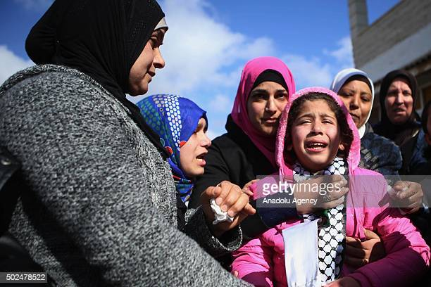 Relatives of Mehdiye Hamid a Palestinian woman who was shot dead after she allegedly drove her car onto Israeli security forces in the Silwad...