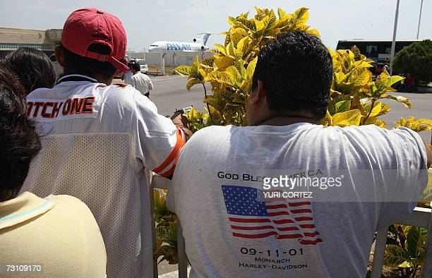 Relatives of members of a group of 117 people deported from the United States wait for their arrival at El Salvador's international airport in...