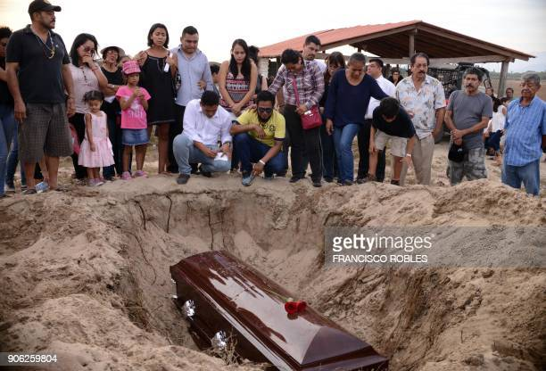 TOPSHOT Relatives of Mexican journalist Carlos Dominguez Rodriguez murdered on January 13 in the state of Tamaulipas attend his funeral in the...
