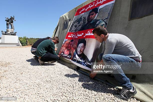 Relatives of missing Lebanese soldiers who were kidnapped by Islamic State militants and alNusra Front in Arsal region near Syrian border attach a...