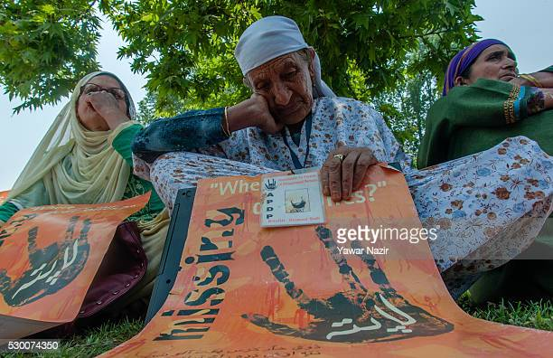 Relatives of missing people attend a demonstration organized by the Association of Parents of Disappeared Persons on May 10 2016 in Srinagar...