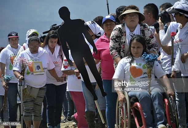 Relatives of missing people attends a ceremony at La Escombrera rubbish dump in the 13 Commune shantytown in Medellin Antioquia department Colombia...