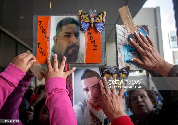 Relatives of missing people in the states of Nuevo Leon and Tamaulipas put photographs of their relatives attorney's office after a march for the...