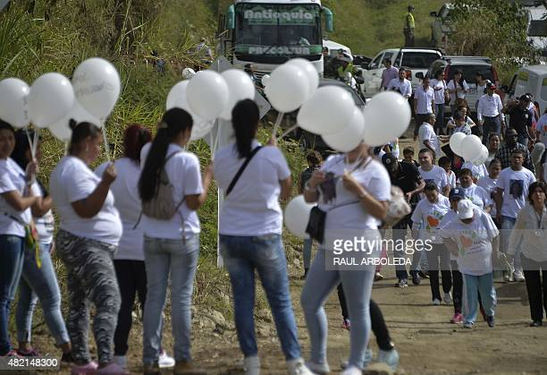 Relatives of missing people participate in a ceremony at La Escombrera rubbish dump in the 13 Commune shantytown in Medellin Antioquia department...