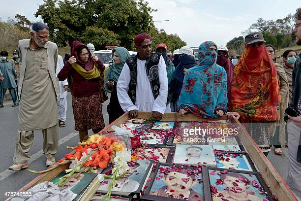 Relatives of missing persons led by Mama Qadir march with a cart of pictures of missing people on their arrival in Islamabad on March 1 2014 The...
